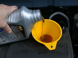 300px-Motor_oil_refill_with_funnel